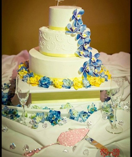 Three Tiers Trimmed in Yellow with Yellow and Blue Flowers