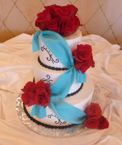 Three Round Tiers with Blue Ribbon and Red Roses