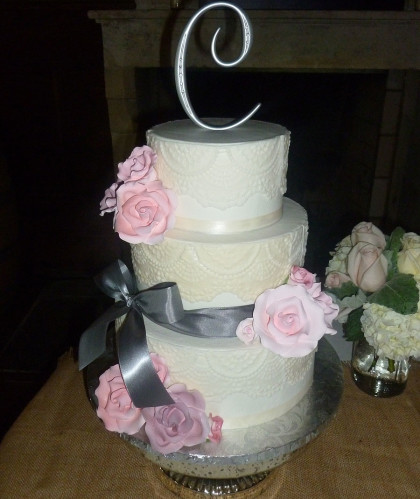 Three Round Tiers with Gray Ribbon and Pink Roses