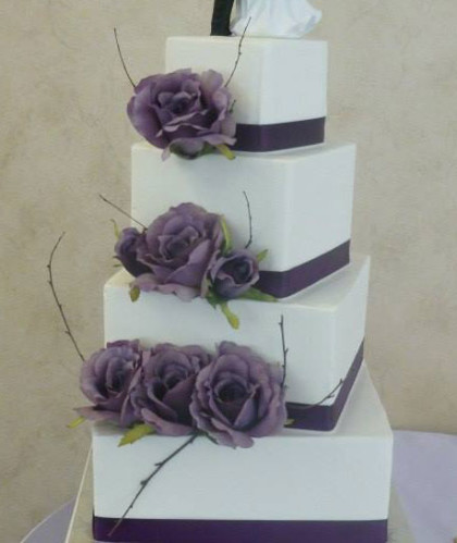 Four Square Tiers with Purple Ribbons and Flowers