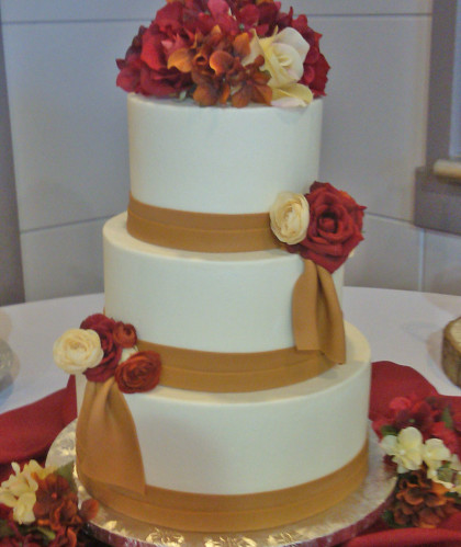 Three Tiers with Gold Sash and Flowers