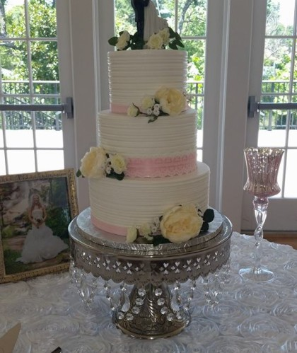 Three Tiers with Roses and Figurine Topper