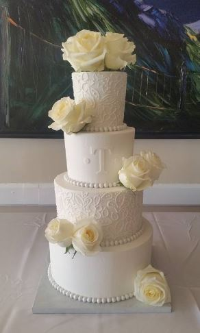 Four Tiers with White Roses and Monogram